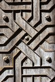 Old aged wooden door iron handcraft deco Stock Photography