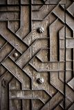 Old aged wooden door iron handcraft deco. Old aged wooden door with iron handcraft deco work spain church Stock Photos