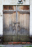 Old aged wooden door with white brick wall in Novodevichy Conven Stock Photos