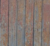 Old aged wooden textured fence. Wood texture background fence wall with paint crackle effect stock image