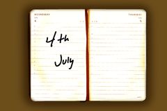 Old agenda with a reminder. On the 4th of July Royalty Free Stock Photos