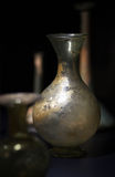 The old ages glass vase standing in the dark. The old ages historical glass vase standing in the dark stock images