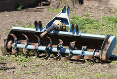Old agricultural equipment. Blue painted old and rusted agricultural equipment Stock Photography