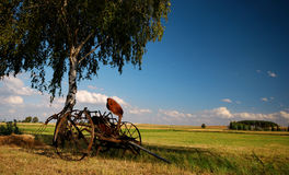 Old agricultural fertilize machine. Old agricultural machine waiting in a meadow Royalty Free Stock Photos