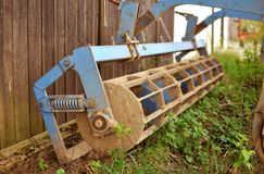 Old agricultural machine with rust and dirt on it, rustic farm e Royalty Free Stock Image