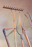 Old agricultural tools. Antique hand scythe, wooden rake, pitchfork of iron and wood stock image
