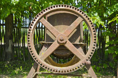 Old agriculture metal wheel in garden Royalty Free Stock Image