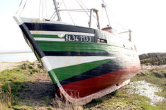 Old aground Fisher boat Stock Image