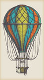 Old Air Balloon. Retro colored hot air balloon on vintage beige background Stock Image