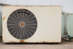 Old air-condition compressor. Outside building Stock Images