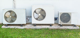 Old air conditioner beside home Royalty Free Stock Photography