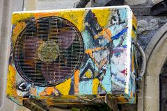 Old air conditioner with street drawings. Old air conditioner with colored abstract drawings in the street royalty free stock photography