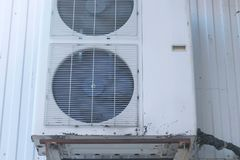 Old air conditioning on the street side. Fans are behind bars. Close-up view. Old air conditioning on the street side. Fans are behind bars. Close-up view royalty free stock images