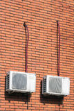 Old air conditioning units. Old air conditioning outdoor units assembled on side of a building Royalty Free Stock Photos