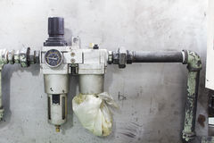Old air filter regulator Stock Images