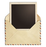 Old air post envelope with polaroid photo frame isolated. On white Royalty Free Stock Photos