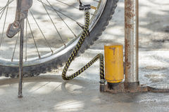 Old air pump and bicycle tire. Royalty Free Stock Photo