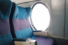 Old aircraft cabin seat near the window. Stock Photo
