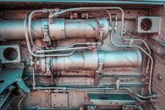 Old aircraft engine closeup with rusty decaying metal pipes and stock photos