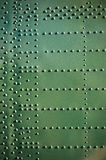 Old aircraft plating background. Old aircraft plating texture with rivets. Grunge wallpaper pattern Royalty Free Stock Image