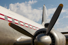 Old aircraft propeller and airframe with blue sky background Stock Photo