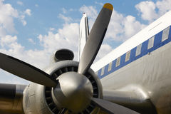 Old aircraft propeller and airframe with blue sky background. Horizontal Royalty Free Stock Photo