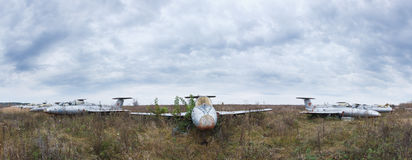 Old aircrafts at abandoned Airbase. Panoramic view of the battered aircraft Stock Images
