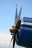 Old airplane. Propeller of old airplane with blue sky Royalty Free Stock Photography