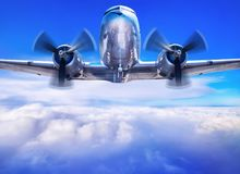 Old airplane against a blue sky stock images