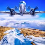Old airplane against a blue sky stock image