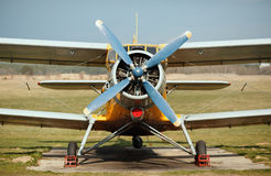 Old airplane. Airplane with blue propeller. Old retro plane close-up. Front view, with the side of the fuselage Royalty Free Stock Photo