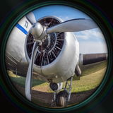Old airplane engine in objective lens Royalty Free Stock Images