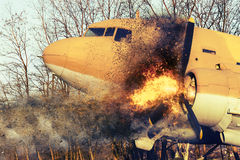 Old airplane on fire Stock Image