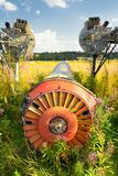Old airplane fuselage on green grass Royalty Free Stock Photo