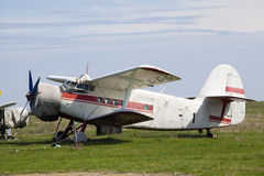 Old airplane on grass. An old airplane on grass Royalty Free Stock Photo