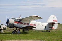 Old airplane on grass. An old airplane on grass royalty free stock photo