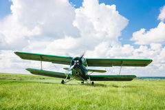 Old airplane. On green grass Stock Images