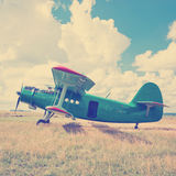 Old airplane on green grass Royalty Free Stock Image