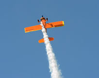 Old airplane performing stunt Royalty Free Stock Photos