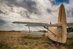 Old airplane. The old plane against the cloudy sky Stock Images