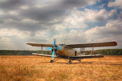 Old airplane. The old plane against the cloudy sky Stock Image