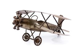 Old airplane toy on white. Old metal airplane toy  on white Stock Photography