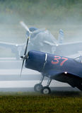 Old Airplanes and Smoke Stock Photography