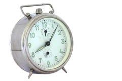 Old alarm clock. Isolated on white Stock Image