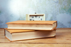 Old alarm clock with books Stock Image