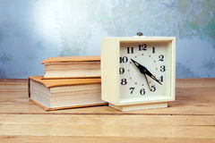 Old alarm clock with books Stock Images