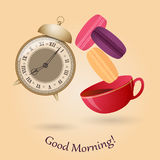 Old alarm clock, cup of tea and macaroons. Good morning. Royalty Free Stock Image