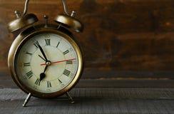 Old alarm clock dark Royalty Free Stock Photography
