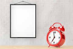 Old Alarm Clock in front of Brick Wall with Blank Frame Royalty Free Stock Images