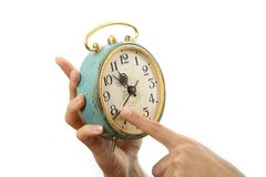 Old alarm clock in hands. Isolated on white Royalty Free Stock Photos